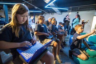 KidsCoin students showcase their technology at the KidsCoin launch